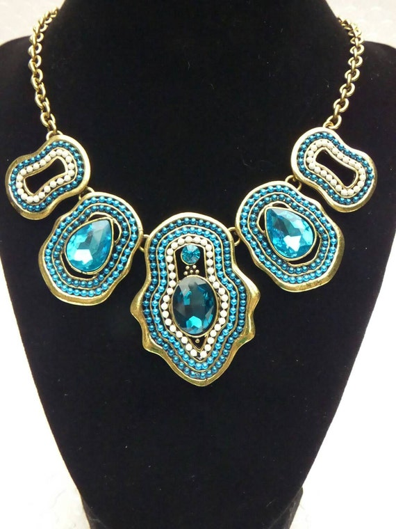 Brilliant Blue and Brass Colored Metal Statement Necklace with White Accents