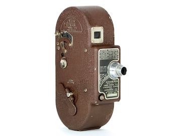 Vintage 1948 Cinklox  Model 3S 16mm Movie Camera – a must for any camera collector and perfect for display.