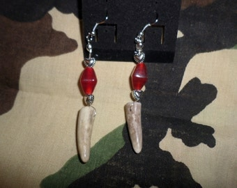 Antler tip earrings adorned with scarlett jewel bead! These dangle earrings add panache to any outing! Versatile looking yet rustic!