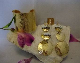 Large gold tone hammered, domed earrings