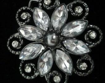 Black and crystal flower brooch