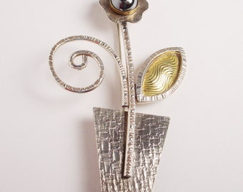 """Hematite Flower in Pot Pin with Textured Brass Leaf """"Waiting to Grow on You"""" in Sterling, Brass, Nickel"""