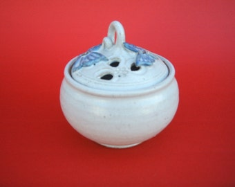 Hand made lidded bowl decorated with butterflies