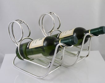 Two classic silverplated bottleholders