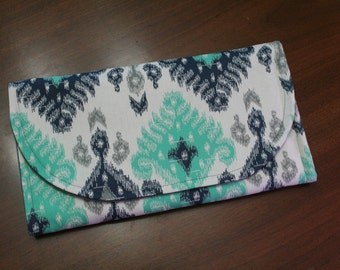 All-in-One Diaper Clutch with Built in Changing Pad - Travel clutch and changing pad - Blues and Greys