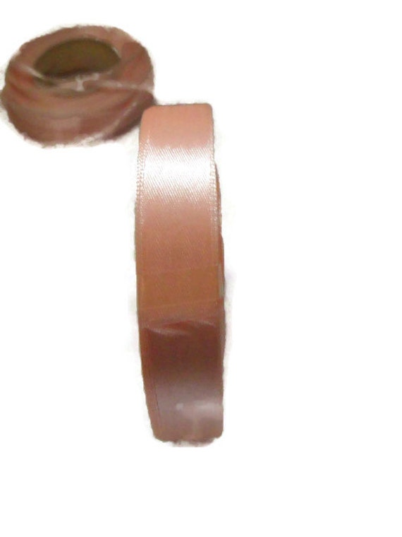 two rolls of peach satin ribbon, 3mm and 15mm, 25m rolls on each, one new one partially used,