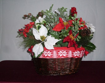 Christmas snow basket, with red and white flowers, holiday berries.