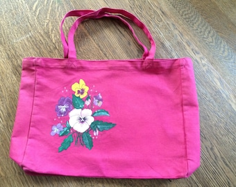 Hot pink canvas bag with hand painted pansies.