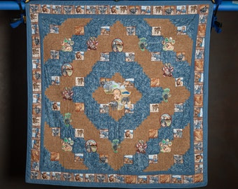 african embroidered, handmade quilt