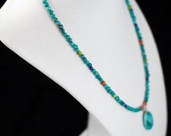 17 inch turquoise nugget silver plated necklace with oval turquoise pendant.