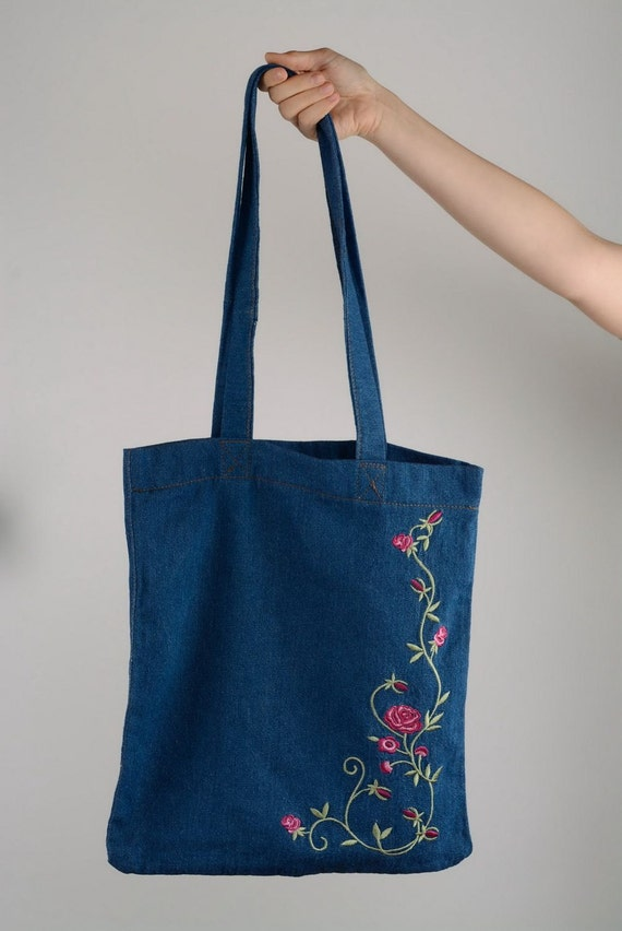 Jeans bag with machine embroidered flowers by
