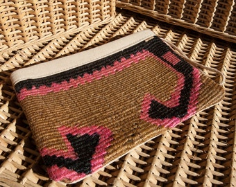 Lovely handmade make up bag re-fashioned from vintage wool, silk and cotton fabric swatches.