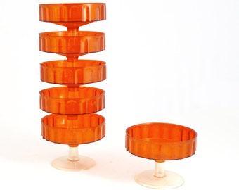 Orange plastic ice or dessert-cups