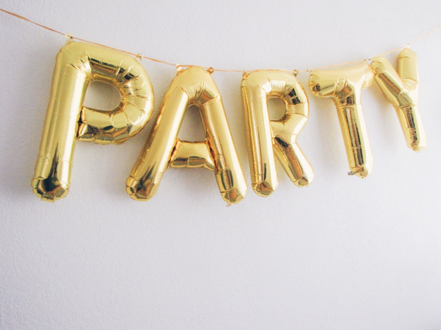 PARTY letter balloons gold foil mylar letter by OhShinyPaperCo