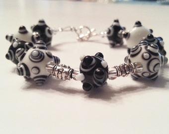 Whimsical Black and White Beaded Bracelet
