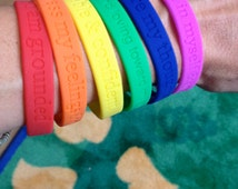 Large (202mm) Chakra Mantra Rubber Wrist Bands - tangible affirmations of the personal power of your energy rainbow, right on your wrist!