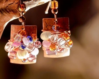 Copper wire wrapped earrings with pearls and glass beads.