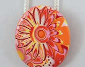 Floral image, pink, yellow, white, red and orange polymer clay pendant in mokume gane technique with silver plated rope chain