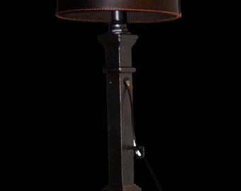 TABLE LAMP made of old bascule, cast-iron base and wooden Lampshade in leather.