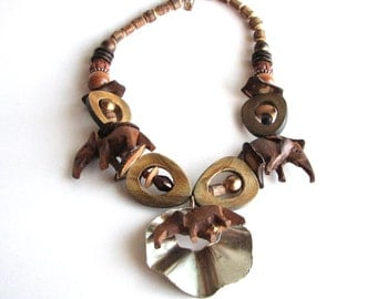 vintage African tribal necklace . boho elephant necklace . wood and metal necklace