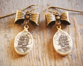 a sailor's life. unique, nautical chic vintage ivory oval scrimshaw ship and antiqued brass bow earrings. ooak by val b.