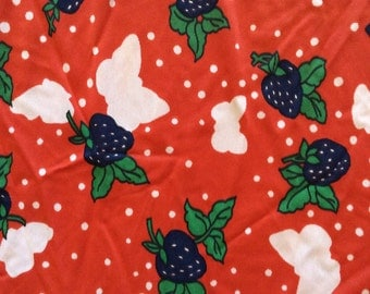 1970's strawberry and ghostly butterfly print jersey, in red, dark blue-purple, green, and pale blush pink, 1 1/2 yards