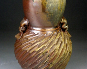 Woodfired Handled Vase with Carved Design.