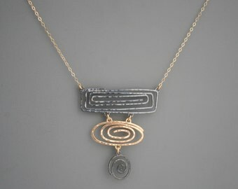 Mixed metal black and gold spiral necklace, Rachel Wilder Handmade jewelry