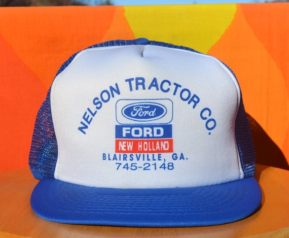 https://www.etsy.com/listing/210527327/80s-vintage-foam-trucker-mesh-hat-ford?ref=shop_home_active_1