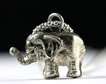 Elephant charm , sterling silver, celluloid cereal charm
