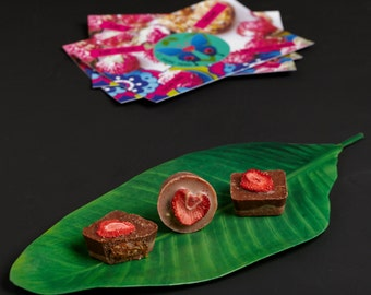 2 Raw chocolates with strawberry almond butter. Vegan, organic, sugar free & gluten free