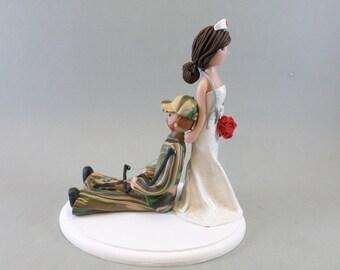 Nurse Dragging Hunter Custom Made Wedding Cake Topper