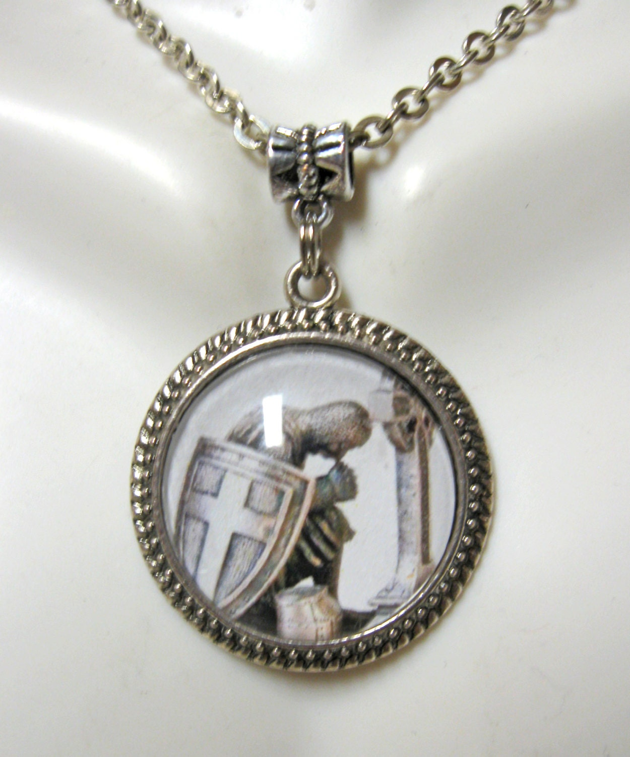 templar in prayer at cross pendant and chain by