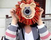 Camera lens buddy.  Crochet camera critter lion.  Photography prop