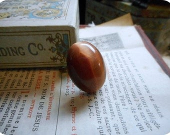 Persimmon. dusty salmon  pink huge domed oval cat's eye shimmery cocktail ring