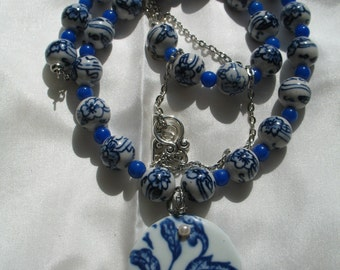 Asian Blue and White porcelain necklace with a round porcelain pendant with silver embellishments