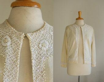 1950s beaded ivory white dolman sleeve cardigan sweater, size medium maybe large