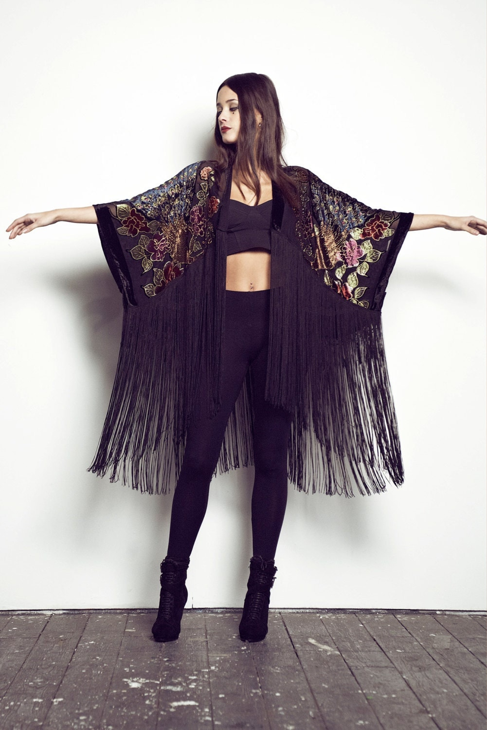 Black hii-low fringe kimono. Pair with denim shorts and a loose tank for a chic boho look!