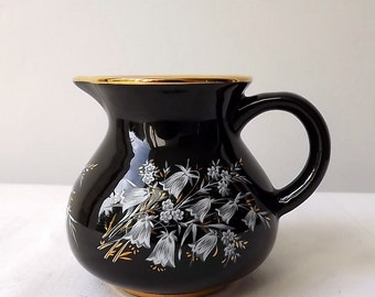 Vintage Prinknash pottery small black and gold jug hand painted with white flowers