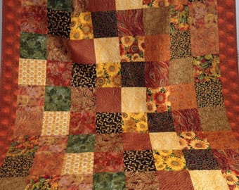 Modern Patchwork Holiday Quilt with Autumn Prints in Yellow Rust Green Orange Red Brown Black