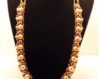 "23"" beaded necklace in browns, gold and copper"