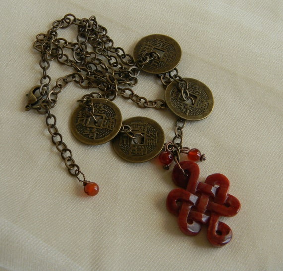 jade infinity knot pendant w coins brass chain