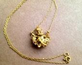 Vintage Gold Toned Swinging Leprechaun Necklace