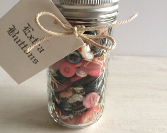 A Quilted Ball Canning Jar Filled With Buttons
