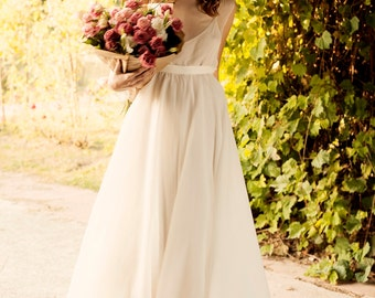 Milk shade open back wedding dress with cotton slip