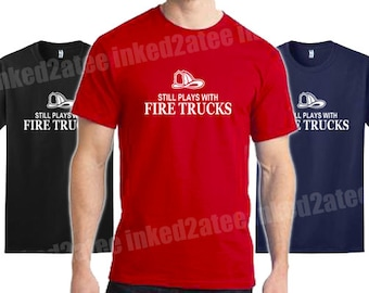 Still plays with fire trucks Mens Tshirt