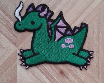 Cute green dragon iron-on patch, fantasy, mythological creature.
