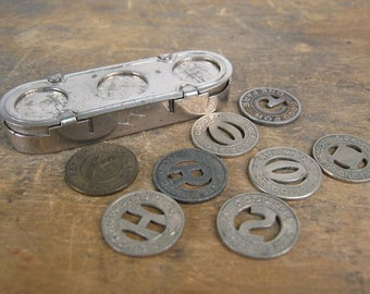 Antique Transit Token Holder with a Variety of Eight Tokens