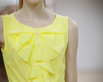 Yellow chiffon top, with flounces