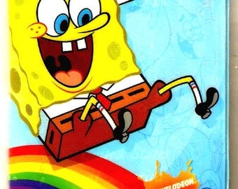 Spongebob Squarepants sliding on Rainbow PASSPORT COVER